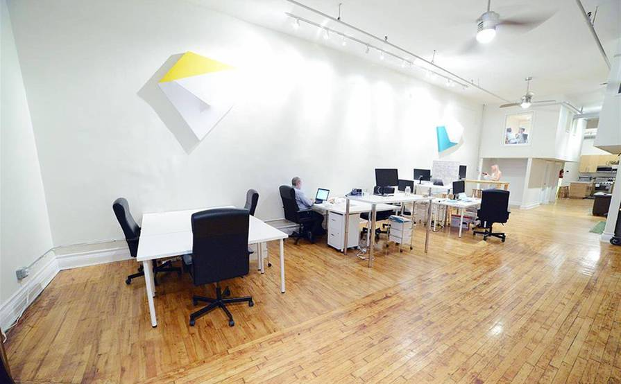 desks in an amazing office space