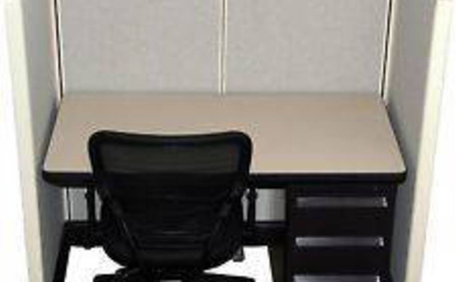 Desk space for rent in a shared office space plus round tables meeting space