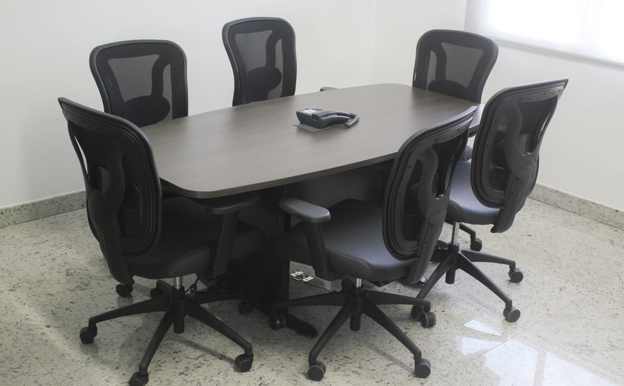 Work stations with private desks, meeting room