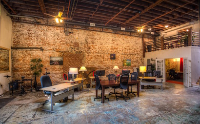 Alkaloid Networks is located in the historic Virginia Cotton Docks warehouse in Old Fourth Ward. The modern, creative loft space has been recently renovated and includes exposed brick walls and 20-foot ceilings.