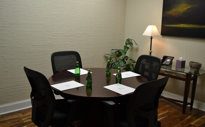 4 person conference room. Ivy Room at Peachtree Offices at Lenox, Inc.