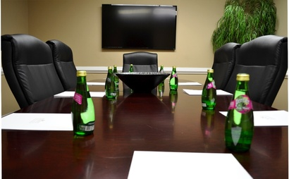 8 person conference room. Maple Room at Peachtree Offices at Lenox, Inc.