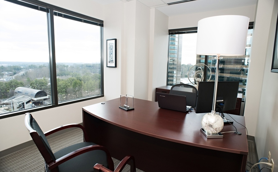 6 person conference room. Peach Room at Peachtree Offices at Lenox, Inc.