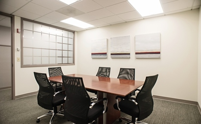 6 person capacity conference room. Library Room at Peachtree Offices at Downtown, Inc.