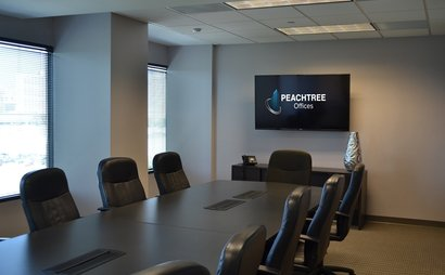 14 person conference room. Lenox Room at Peachtree Offices at Lenox, Inc.