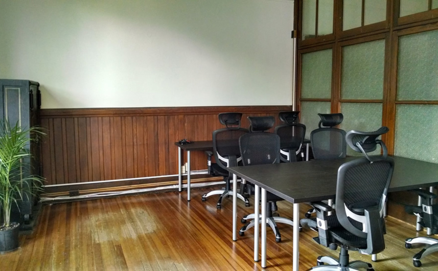 Open desks and tables in coworking space