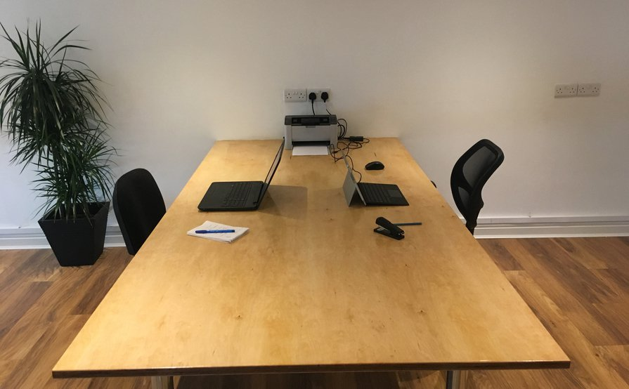A large 2m wide desk in a quiet working enviornment