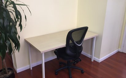 Desk in Spacious and Brightly-Lit Corner of a Midtown Animation Studio
