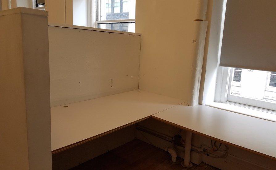 Semi-private corner workspace in quiet creative office