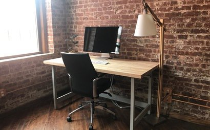 Sunny Desk with Exposed Brick & Original Wood Floors