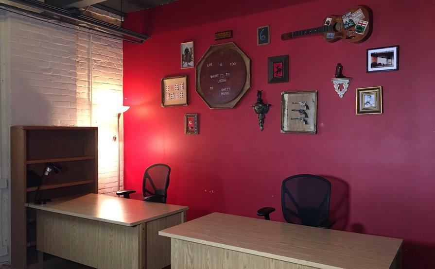 Desks in an open, shared workspace