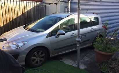 Open back yard secure parking, city fringe