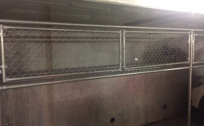 Multiple lockup storage cages in secure underground car park.