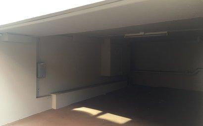 Undercover car space with security door