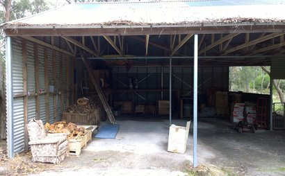 2 bays of large shed. Dirt floor.