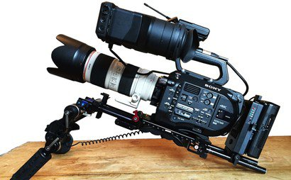 Sony FS7 Full shooting kit with EF speed booster, Canon zooms, tripod and radio mics